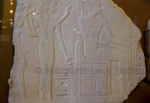 Stela Depicting Ahmose-Nefertari Behind the Seated God Amun with Her Son Amenhotep I Behind Her